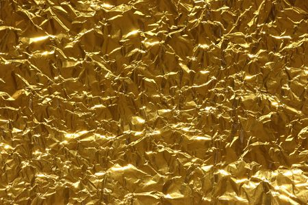 scrunch: Abstract metallic background of gold color Stock Photo