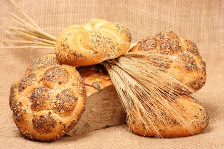 Various types of baked goods on with spikes of grain