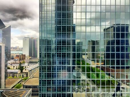 stormy clouds: Stormy Clouds over the financial business Center of a city Stock Photo