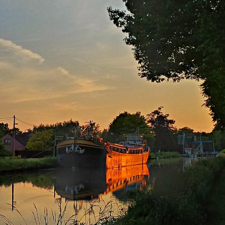 dramatic sky: Dramatic Sky over a Canal Stock Photo