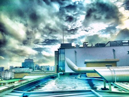 industrial: Dramatic Sky over An Industrial setting Stock Photo