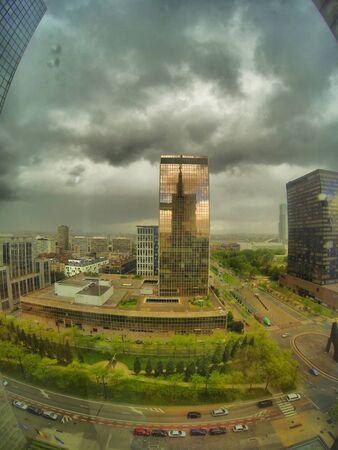 industrial: Dramatic Sky over the financial business center of the city Stock Photo
