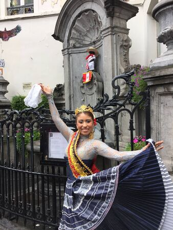 style: Traditional Peruvian Marinera style dancer and manneken pis statue in Brussels Stock Photo