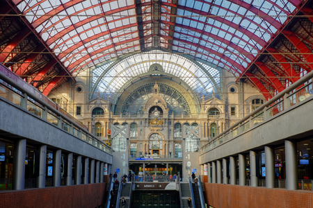 Tourists and commuters in the beautiful historic Antwerp Central train station, in Antwerp, Belgium, Europe Archivio Fotografico