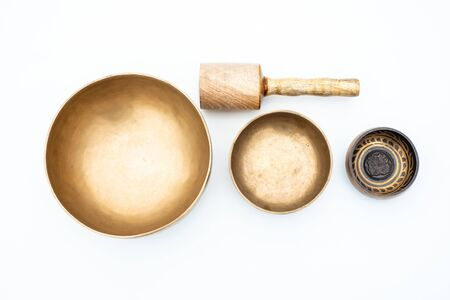 Flat lay composition of Ancient hand crafted traditional Tibetan meditation and healing singing bowls made from 7 sacred metals which are typical accessories used in buddhism, yoga and meditation