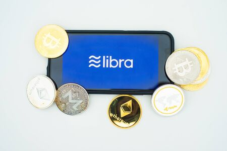 The new currency Lybra from Facebook on a smartphone depicted with some of the current cryptocurrencies Sajtókép