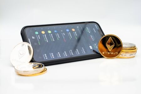 Cryptocurrency stock market app open on a smartphone depicted with some of the current cryptocurrencies