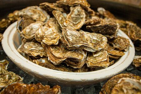 Healthy sea food, fresh Oysters gourmet close-up on white plate served in a restaurant Stock Photo