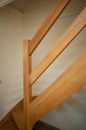 wooden staircase in the interior of a white modern residential house