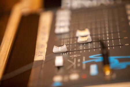Closeup of an audio mixing control panel, dj equipment. Dj Music club life concept Standard-Bild