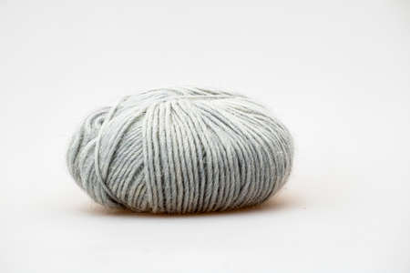 Grey blue colored ball of threads wool yarn on white background. High quality photo