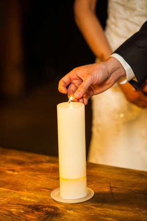 The groom and the bride with candles. Wedding ceremony in church. High quality photo 스톡 콘텐츠