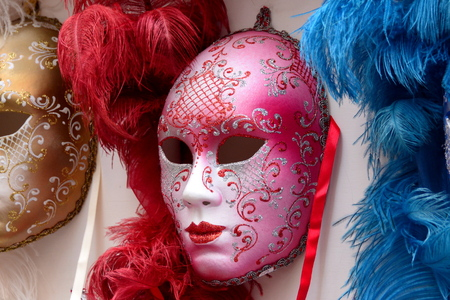 disguise: Colorful venetian masks waiting for a face to disguise. Stock Photo