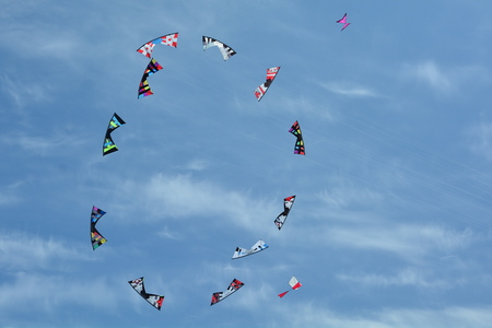 paper kites: Kites flying in unison on a sunny summers day.