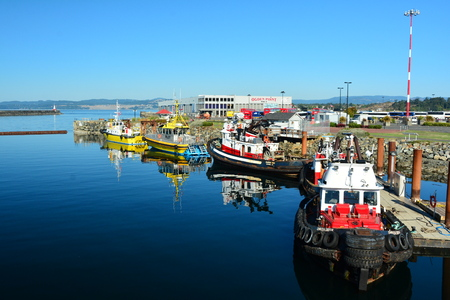 victoria bc: Ogden Point,Victoria BC,Canada.Pilot boats and tugs ready for action at Ogden point when called. Editorial