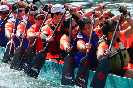 Victoria BC,Canada.The annual dragon boat festival makes for tough competition between paddling teams.The race is full of fun and excitement.Come to Victoria and row.