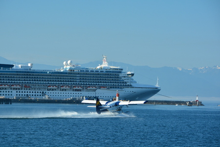 victoria bc: Float plane taking off from inner harbor in Victoria BC,Canada,while a cruise ship watches