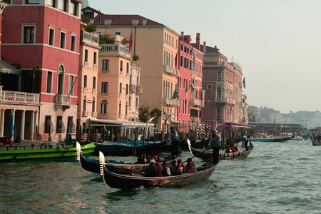 gondoliers: Gondolas and gondoliers take tourists for a ride on the Grand Canal in Venice Italy. Editorial