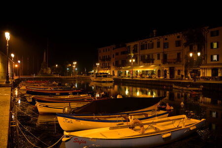 Nightime scene in Lazise Italy.Harbor in Lazise Italy on Lake Garda. Editorial