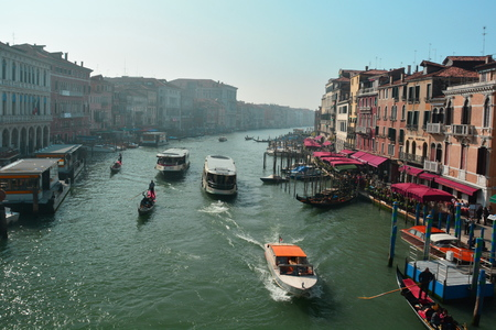 gondoliers: View of Venice and the grand canal from the Rialto bridge. Editorial