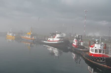 british weather: Ogden Point,Victoria BC,Canada and the tugboats