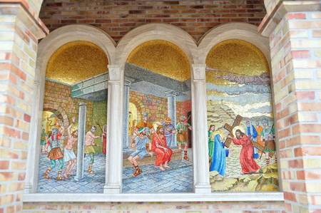 depicted: Religious mosaic scenes depicted on the wall. Editorial
