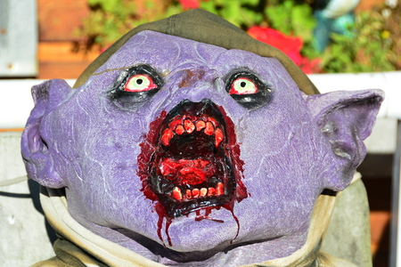 ogre: Scary Halloween ogre greets visitors,I want your blood. Stock Photo