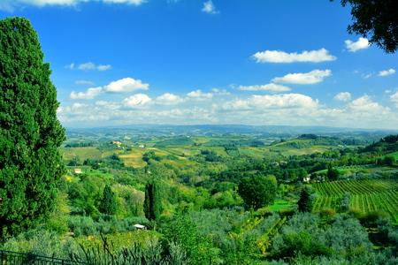 fertile land: Italian countyside outside of the hilltown of San Gimignano in Tuscany Italy. Stock Photo