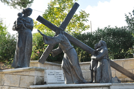 carrying the cross: Station eight of the Stations of the Cross.