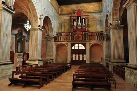 church interior: Italian church interior with pews  and organ.