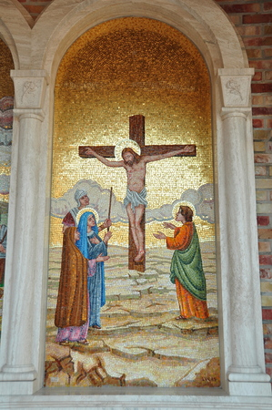 bible story: Religious mosaic artwork of Christ on the cross.