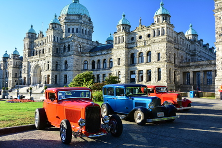 victoria bc: Classic cars in front of BC parliament buildings in Victoria BC Editorial