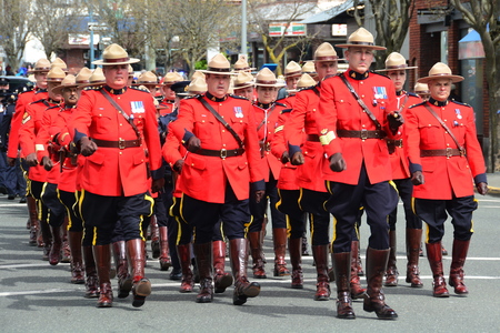 Marching RCMP police officers on their way to a funeral for a fallen officer. Éditoriale