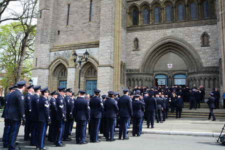 Police officers line up to enter the church for a fallen officers funeral.