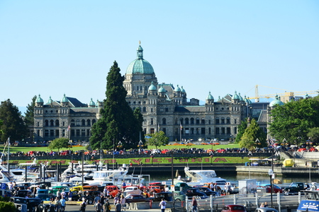 Victoria BC'S inner harbor and parliament buildings on a beautiful summers day.