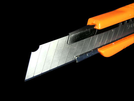 disjoint: Knife for a paper (an isolated, black background)