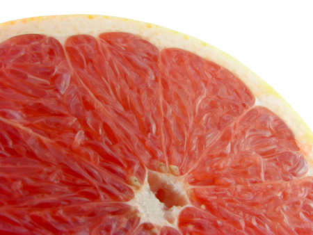 Slices of a grapefruit. A close up. It is isolated on a white background. Stock Photo - 1201943