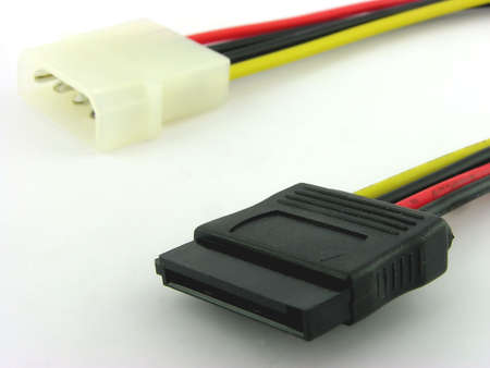 ata: SATA power connector. A close up. It is isolated on a white background.