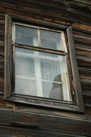 A old window on wood wall. Close-up. Stock Photo - 1666516