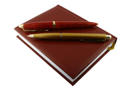 Pen and diary. It is isolated on a white background. A close up. photo
