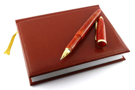 Pen and diary. It is isolated on a white background. A close up. Stock Photo - 1770923