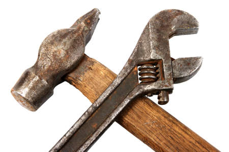 fix jaw: Hammer and spanner. Old and dirty condition. Under construction symbol. Isolated on white.