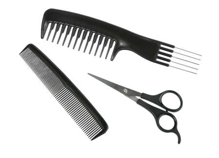 Two black professional combs and scissors. Close-up. Isolated on white background. photo