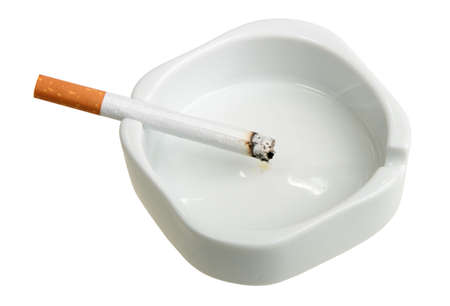 clean lungs: White ashtray with cigarette. Close-up. Isolated on white background.