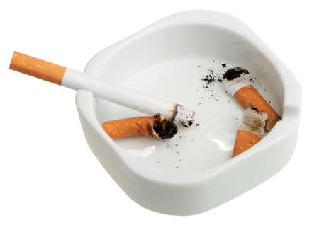 ashtray: White ashtray with a smoking butts and cigarette. Close-up. Isolated on white background.