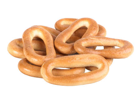 rubicund: Heap of rubicund bagels. Isolated on white background. Close-up.