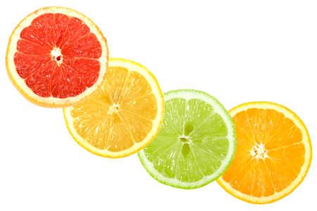 Set of cross citrus fruits. Isolated on white background. Close-up. photo