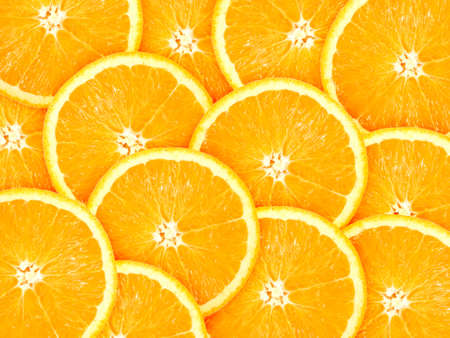 citrus fruits: Abstract background with citrus-fruit of orange slices. Close-up. Studio photography.