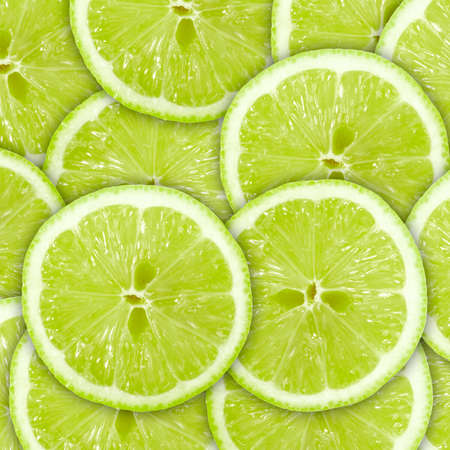 Abstract green background with citrus-fruit of lime slices. Close-up. Studio photography. Stock Photo