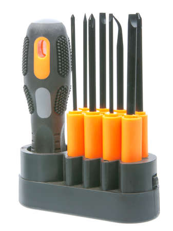 Set of orange-black screwdrivers with bits. New condition. Close-up. Isolated on white background photo